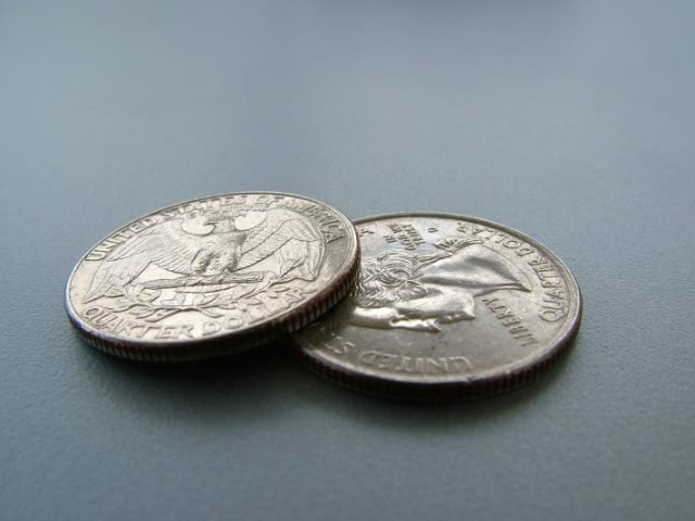 two coins on a gray table