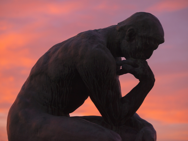 Sculpture of the thinker of Rodin at Waldermarsudde at sunset