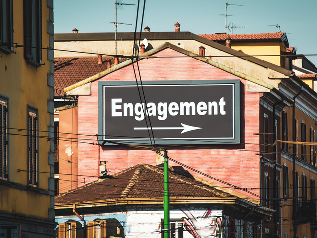 A city billboard/sign pointing the way to engagement