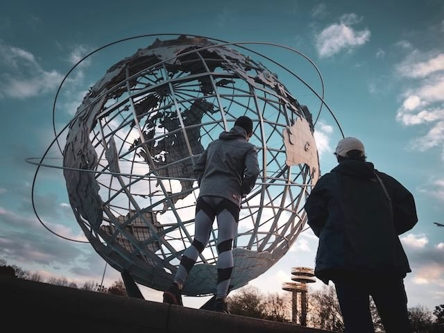 globe with jogger in foreground in Flushing Meadow Queens