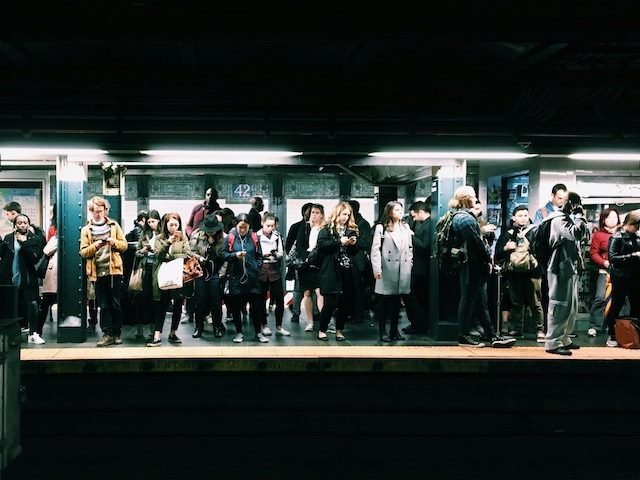 crowd of people on a subway platform