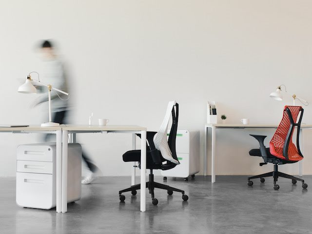 blurred person rushing through  an  empty open plan office