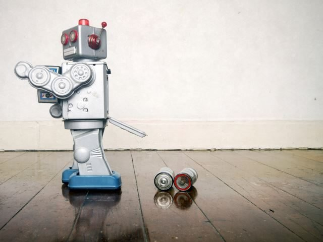 A robot toy that lost its batteries - artificial intelligence business failure concept