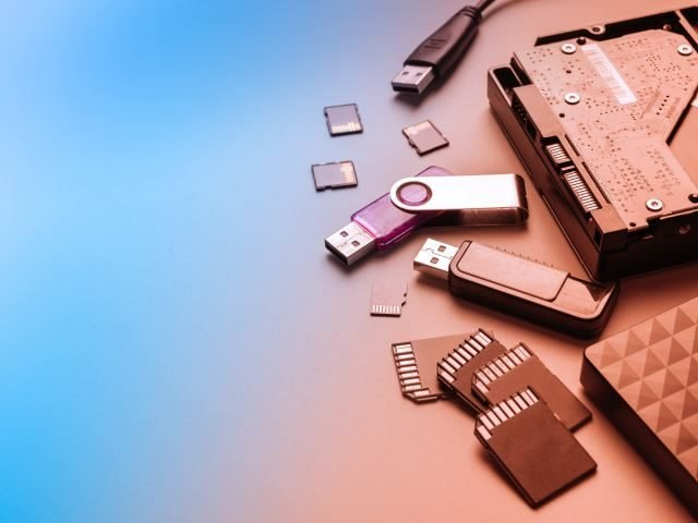 Conceptual World Backup Day background, memory cards, hard drives, and thumb drives