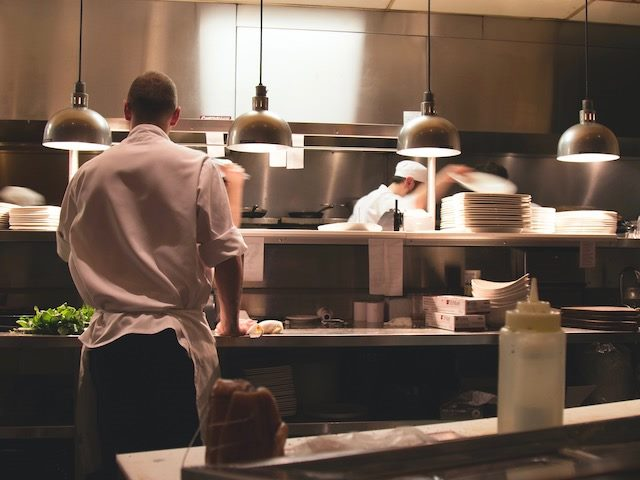 chefs  at  work in  a  restaurant  kitchen
