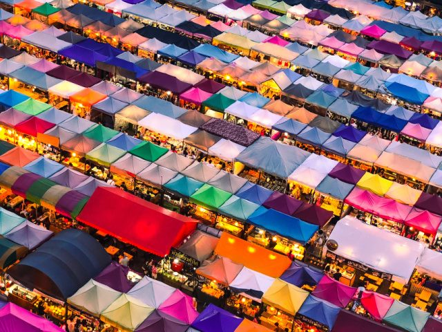 aerial photo of a crowded colorful marketplace in Bangkok Thailand