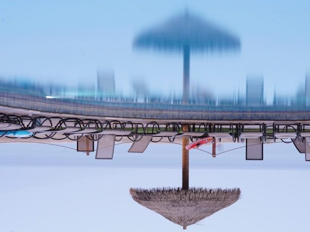 upside down reflection of an empty pool deck