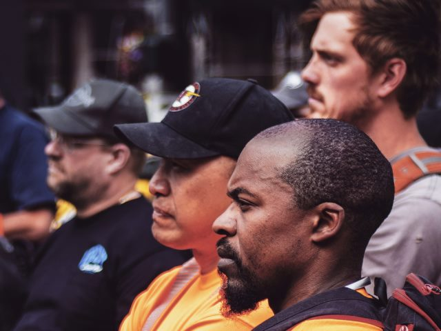 photo of four men at a union rally in Seattle