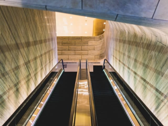 looking up at a set of escalators in an office building