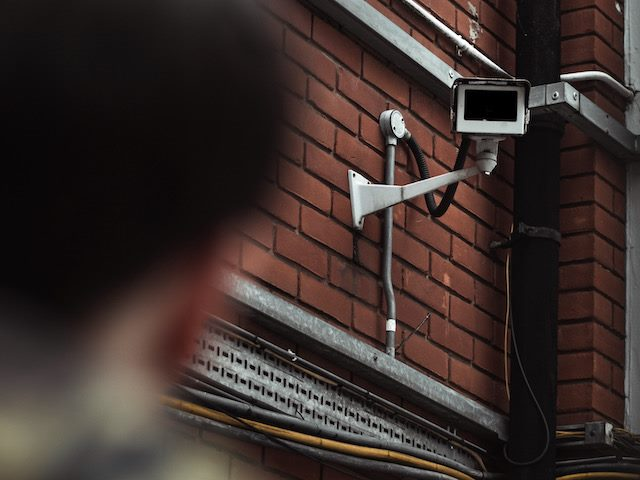 camera watching man,  implication of facial recognition