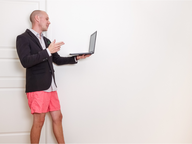 A man on a video conference job interview with a suit jacket but no pants -  Video Interview Concept