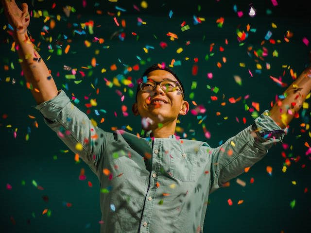 man surrounded by confetti
