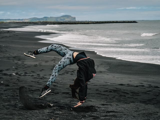 back flip on a beach in Iceland