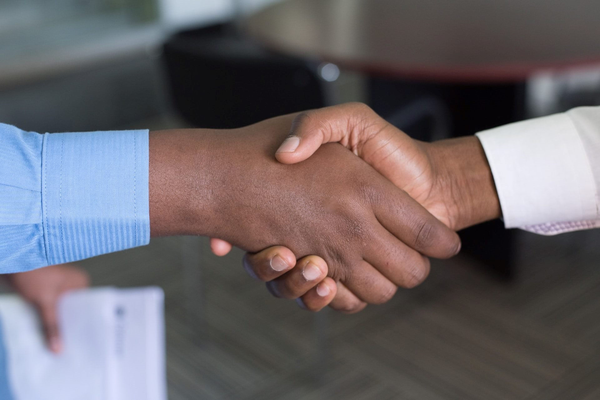 shaking hands in business setting