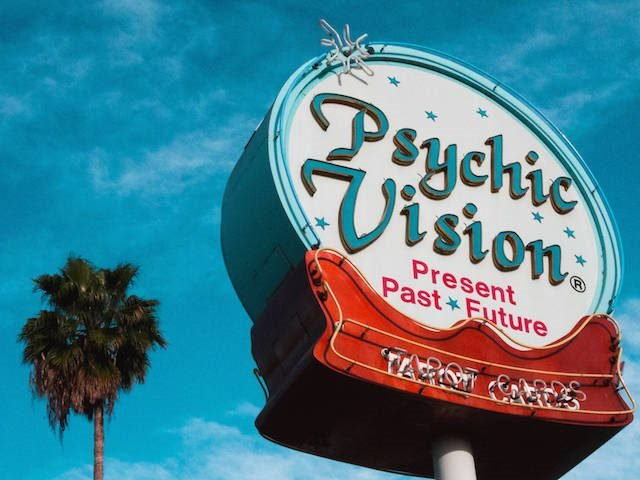 neon sign advertising a psychic