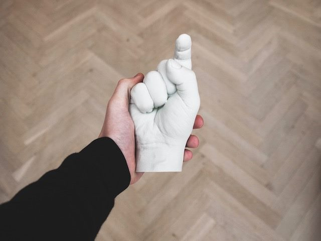 sculpture of a hand with an index finger pointing