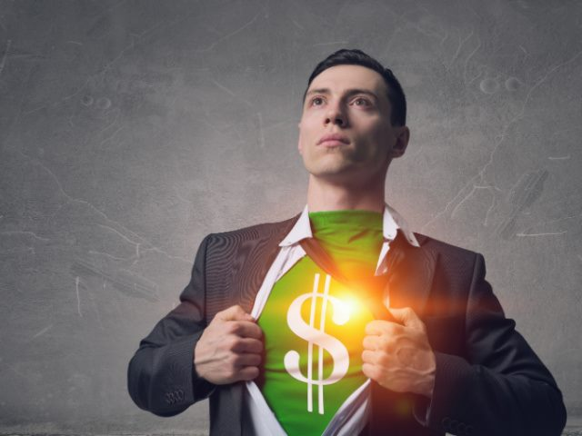 man mimicking a superhero revealing a green shirt underneath his suit with a dollar sign