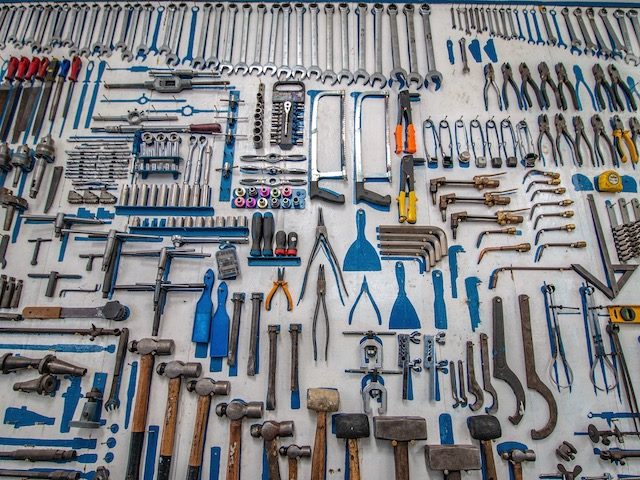 many many tools laid out  on the ground in geometric design