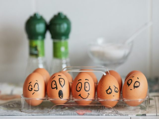 painted eggs expressing a range of emotions from joy to depression