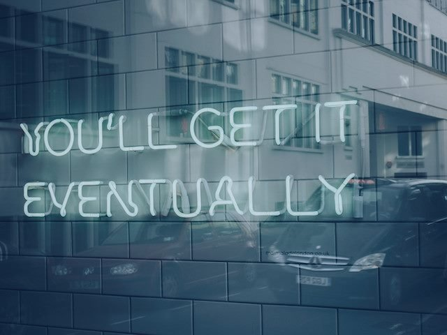 "neon sign that says ""You'll Get it Eventually"""