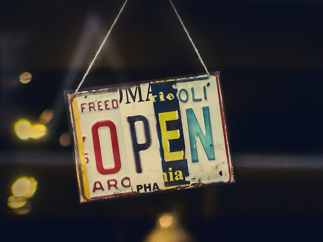open sign in a doorway