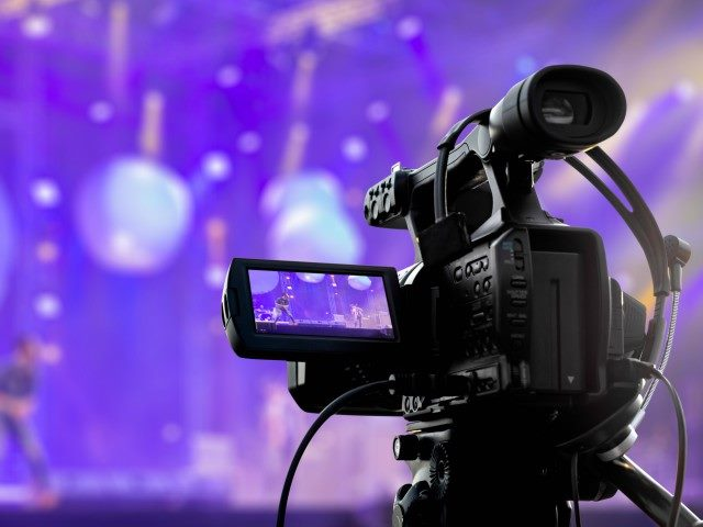 Video production covering event on stage.