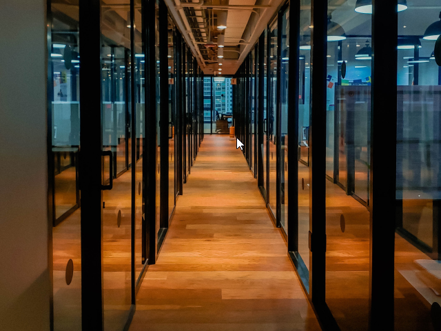 A long and empty workplace hallway - Hybrid Workplace Concept