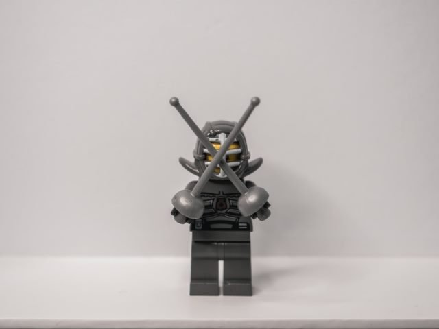 Lego fencer minifigure with swords crossed in front of face