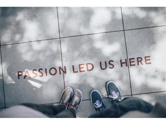 passion led us here message on sidewalk