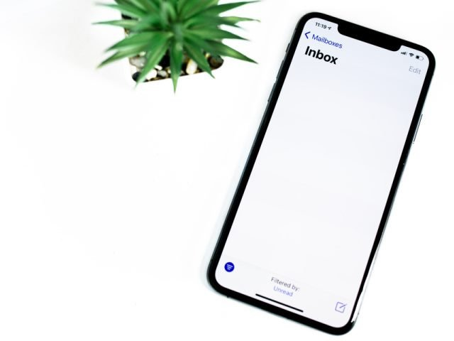 black iphone on a white background showing an empty inbox