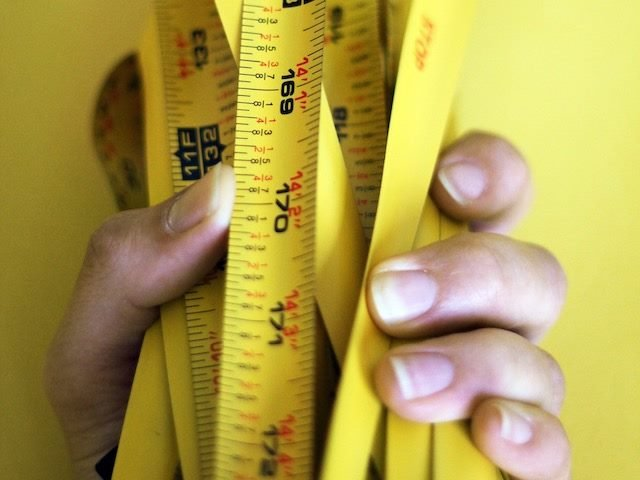 holding measuring tape