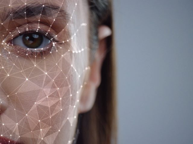 young woman with facial recognition grid overlay on her face