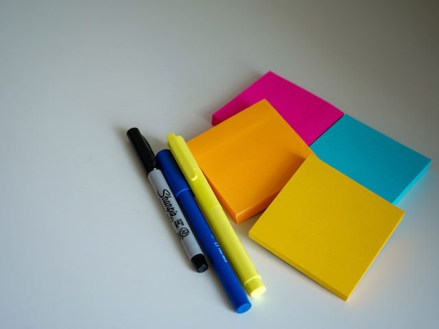 sticky notes and pens