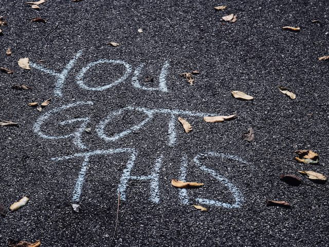 """you got this"" written in chalk on a sidewalk"