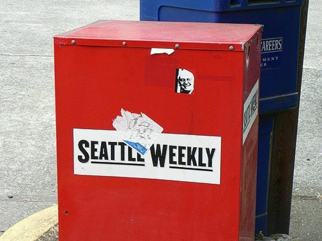 A red Seattle Weekly newspaper box.