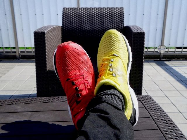 a person wearing mismatched sneakers, one yellow one red