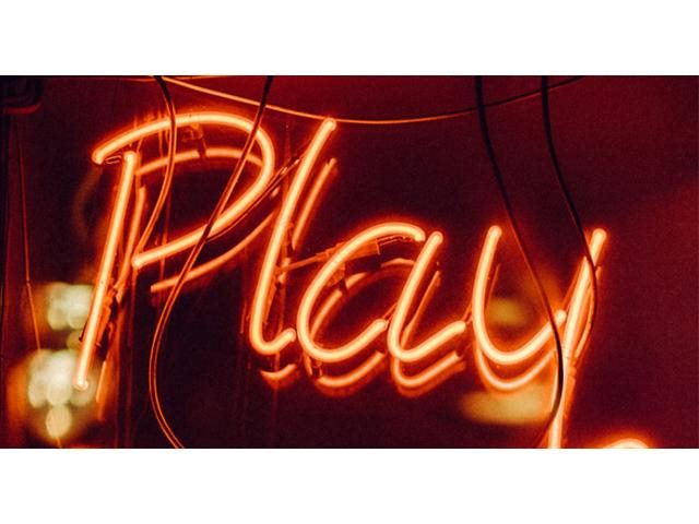 red neon play sign
